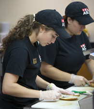 ASC students working at a food preparation station