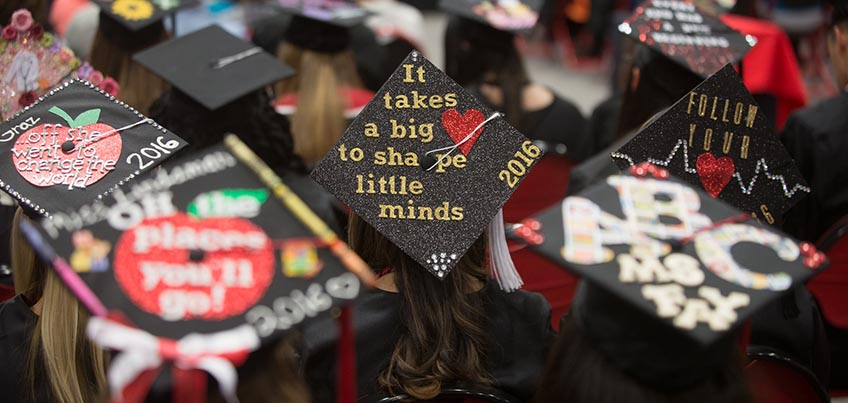 Education majors with decorated caps