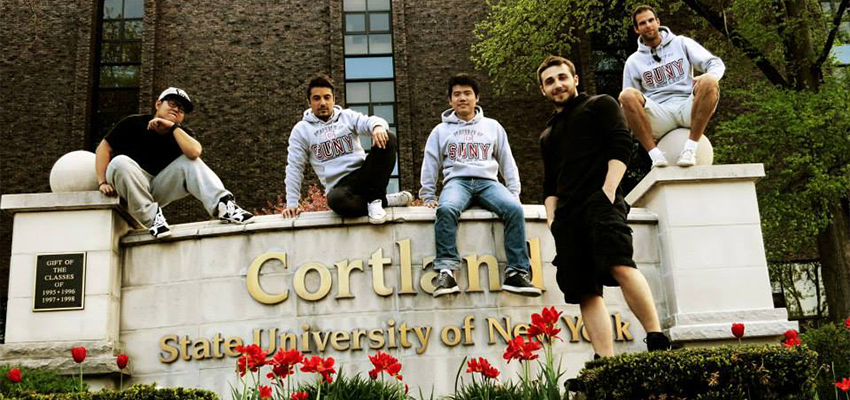 International Students Posing for the Cortland Sign