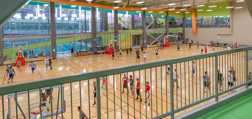 Students playing basketball in the indoor Student Life Center court