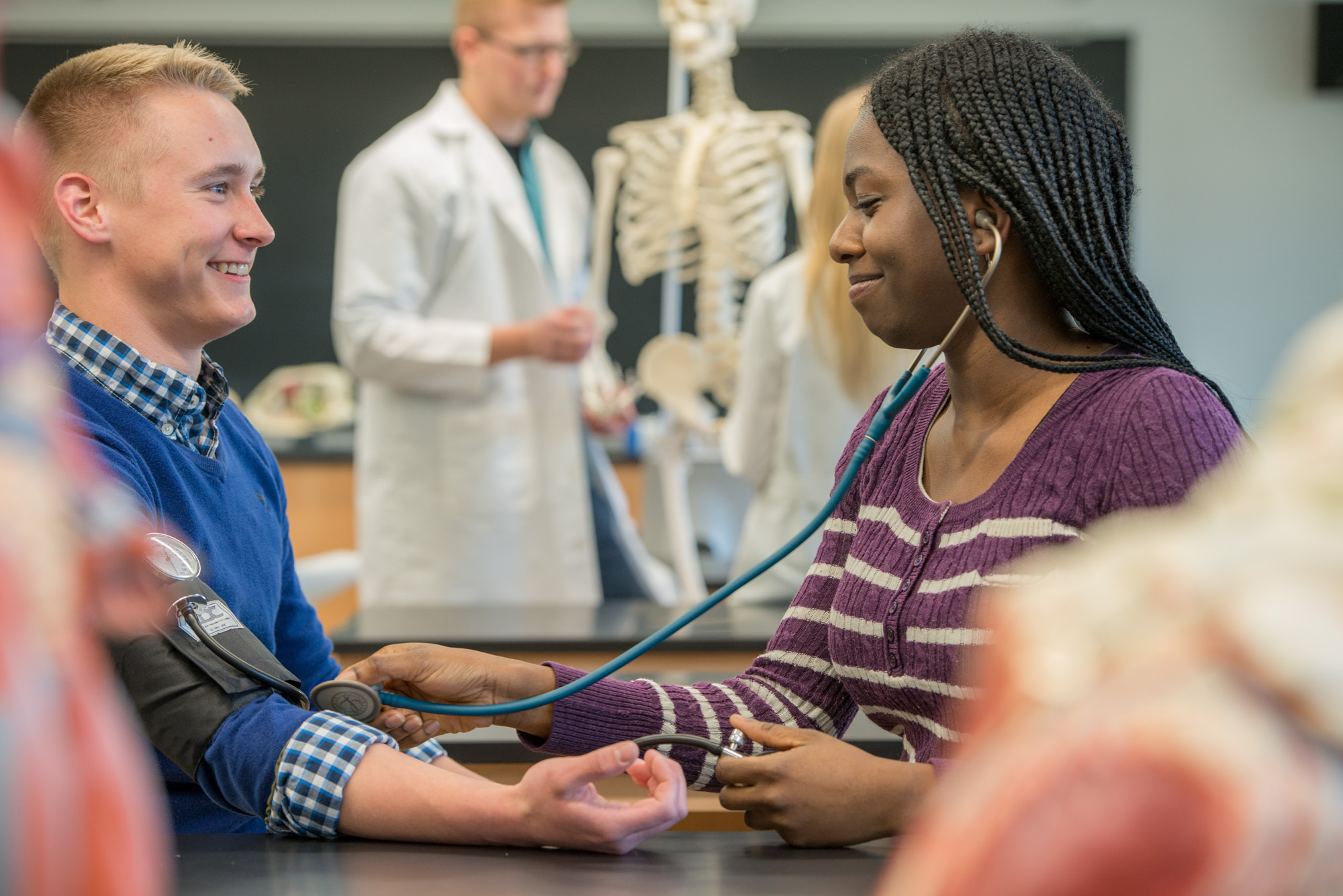 Pre-Med Club practices blood pressure in Bowers Lab