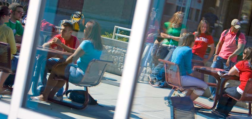 Students sitting outside of Glass Tower Hall
