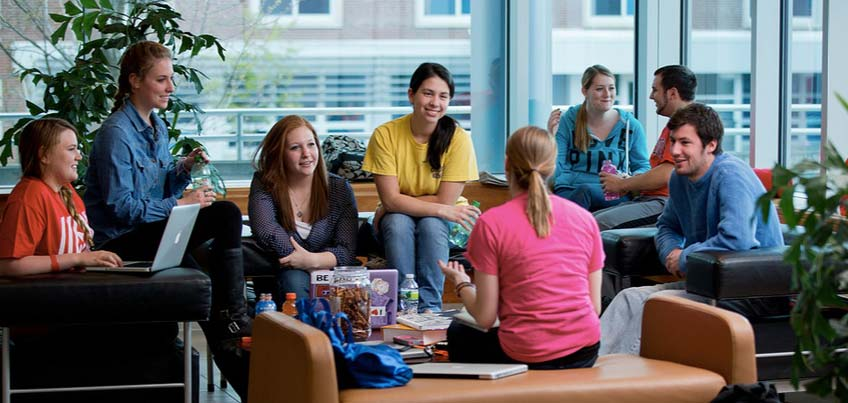 Students hanging out in the common room of Glass Tower Hall