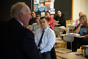 Former Wall Street Titan Speaks to Students