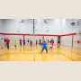 Students in adapted physical education engage youngsters in a game of noodle tag.