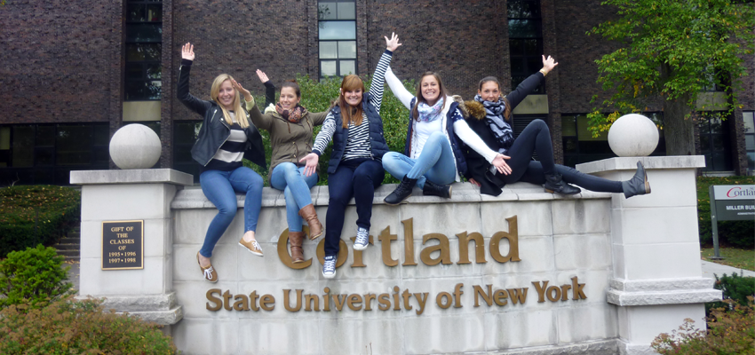 Visiting Students on Cortland Sign
