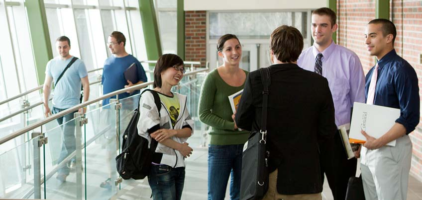 Graduate students chatting in hallway