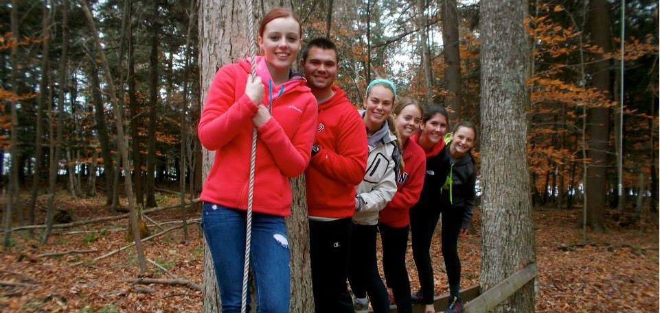 Group of students on a ropes activity course