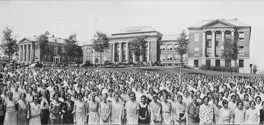 Commencement photo from the 1920s with Old Main in the background