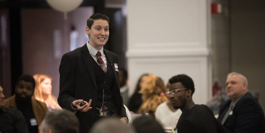 Jamie Piperato '12 speaks to an audience at a diversity conference