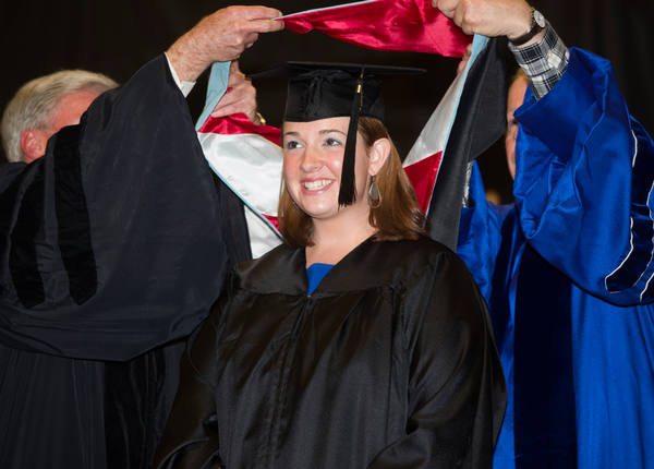 EDL graduate receives hood at Graduate Commencement