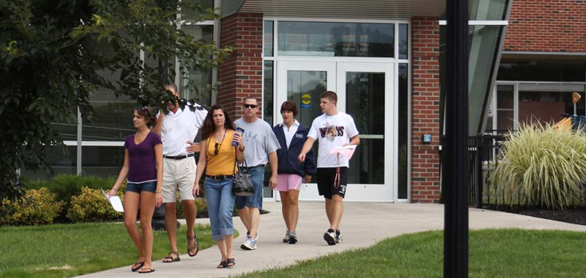 Parents and students walking on campus