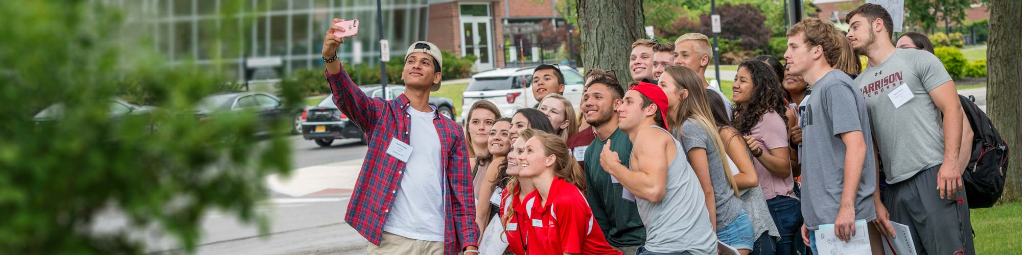 Orientation students pause for a group selfie