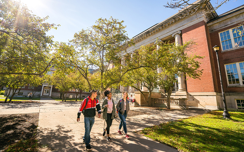 Students walking outside Old Main on a sunny day in Fall 2017