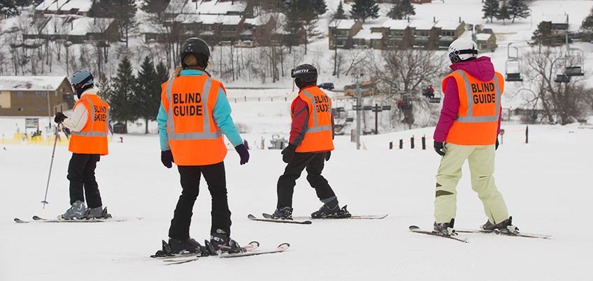 Guides help people who are blind learn to ski