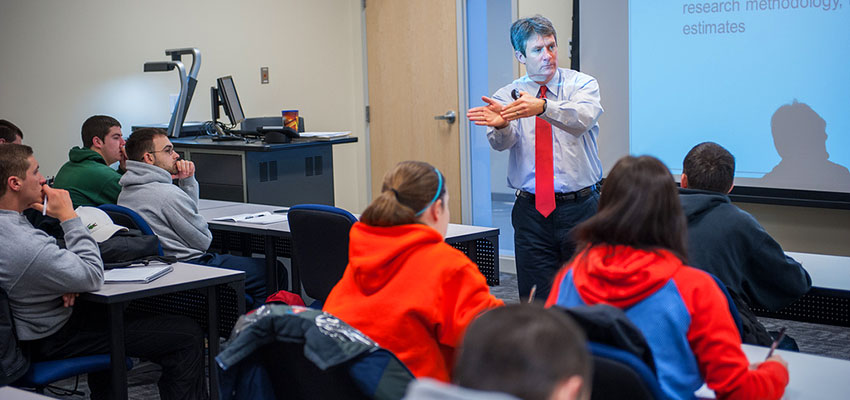 An instructor leads a sports management class lecture