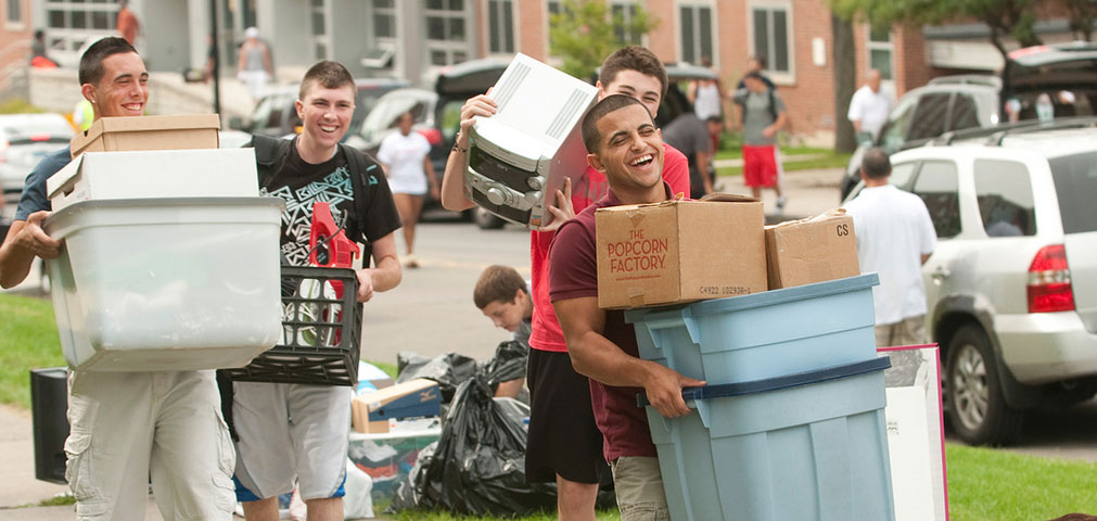 Student athletes carrying boxes on move-in day