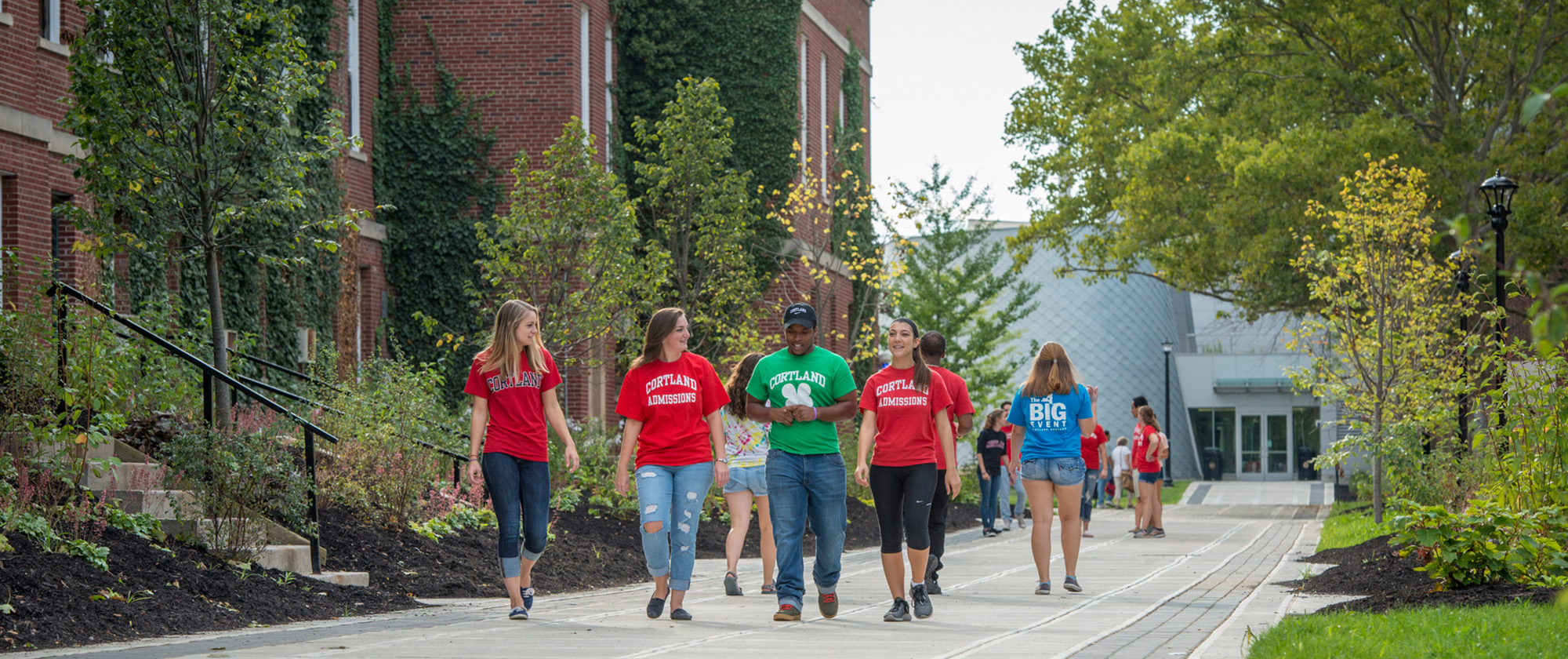 Tour guides walking between Moffett Center and Old Main