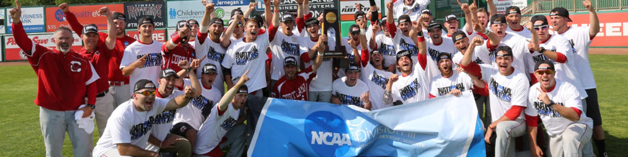 Baseball team holding up their NCAA trophy