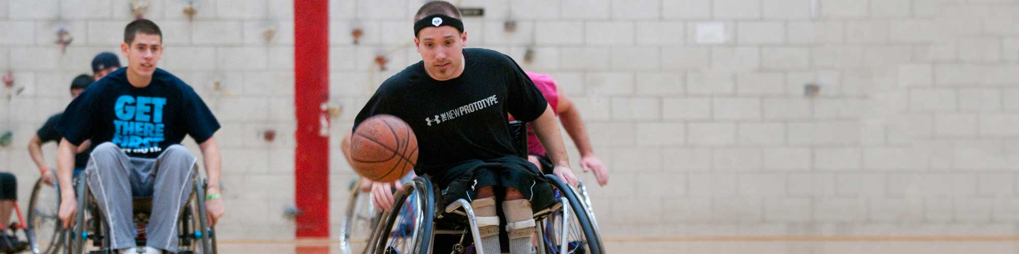 Physical education majors compete in wheelchair basketball.