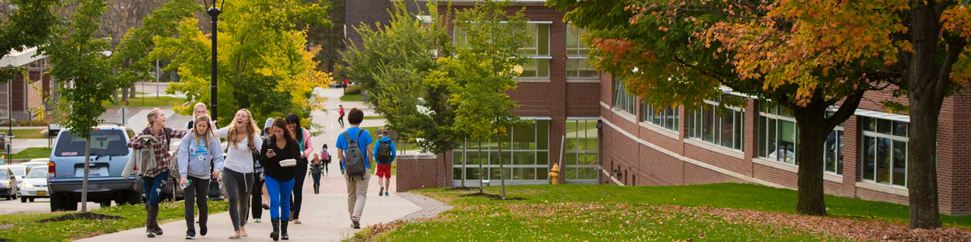 SUNY Cortland students enjoy a walk up the hill in the fall.