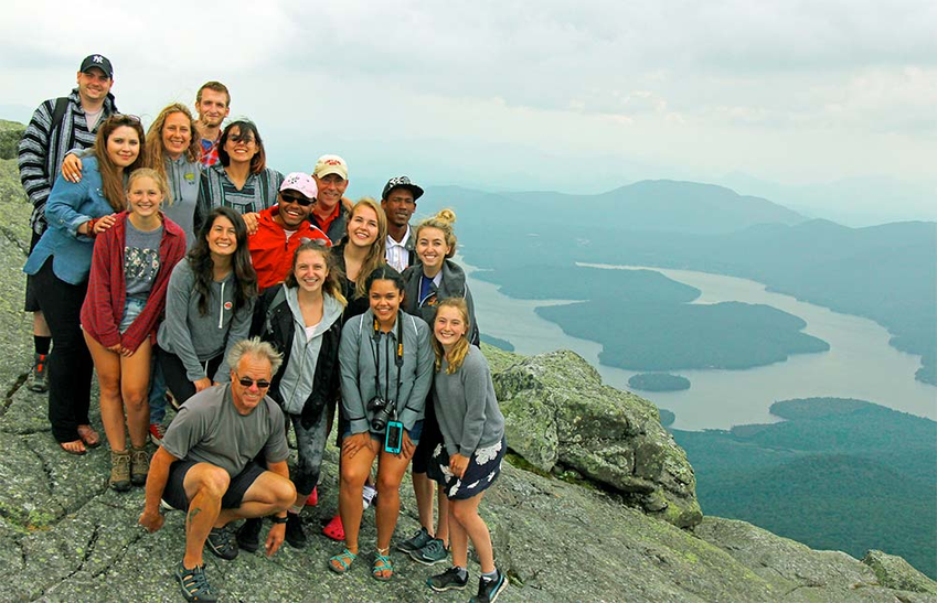 Broyles students pose on top of a mountain