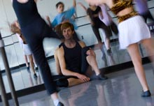 A dance instructor views his dance class