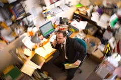 A staff member in his office, viewed from above using an optical radial blur