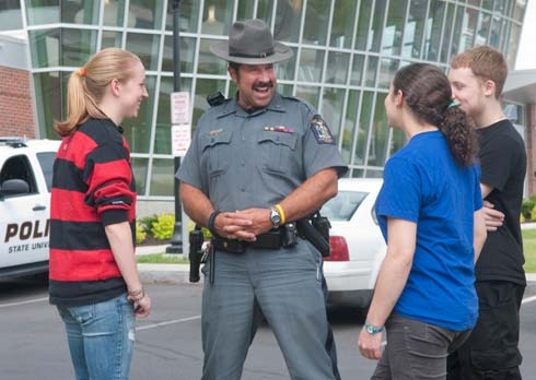 Picture of an officer speaking to students