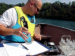 Photo of a student collecting water sample data