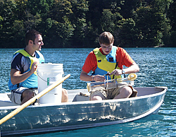 Photo of students taking water samples