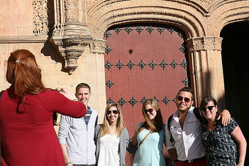 snapping a photo of students studying abroad