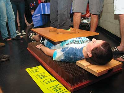 Physics Club Demonstrates a bed of nails