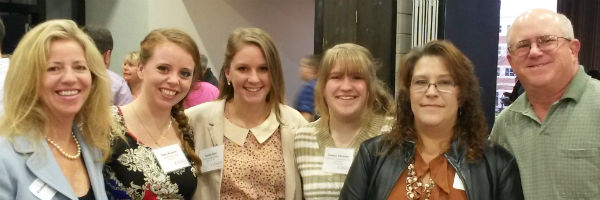 Louisa Frick, Casey Knutson and Katelyn Schroeder together with family members at the President's List Reception