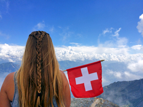 Girl looking over Swiss Alps