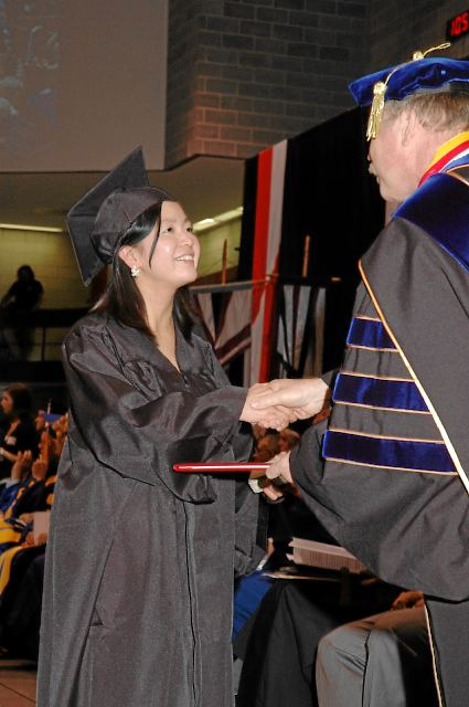 Student receiving diploma cover
