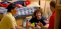 Guys hanging out in dorm room