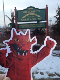 Blaze cut out in front of welcome to cortland sign
