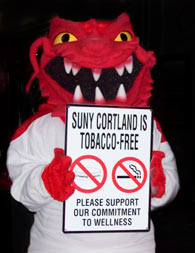 "Blaze holding ""SUNY Cortland is Tobacco-Free - Please support our commitment to wellness"" sign."