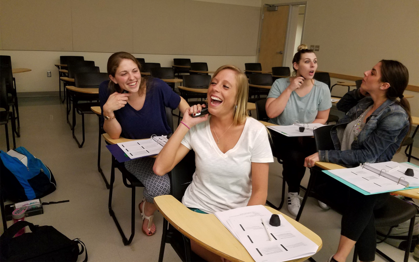 Students use the electrolarynx in their Voice Disorders class