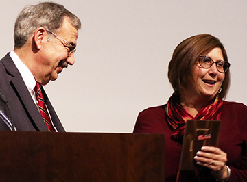 Rhonda McLaughlin receives her award from President Bitterbaum