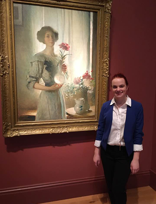 Claire Leggett stands in front of a painting at the Smithsonian National Portrait Gallery.