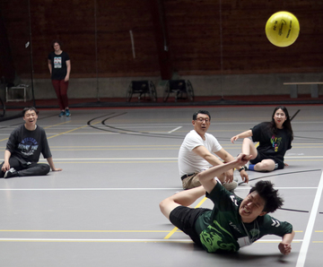 Students play adapted volleyball in Lusk Field House