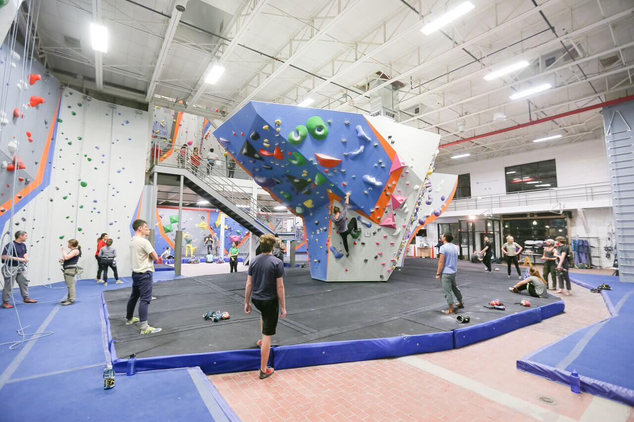 Central Rock Climbing Gym with people climbing